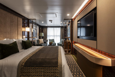 """""""Horizon"""" category staterooms aboard Atlas Ocean Voyages' World Navigator. The stateroom measures 270 sq. ft. and features a floor-to-ceiling window, where the top-half glass panel lowers to create a Juliet balcony."""