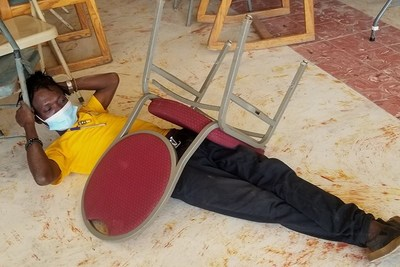 In a simulation of a person trapped under rubble, attendees practiced safely rescuing a person from a collapsed building.